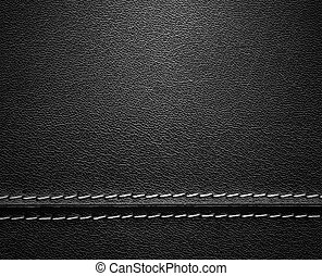 Real close-up of black leather texture with stitch