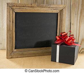 black wooden blackboard with present
