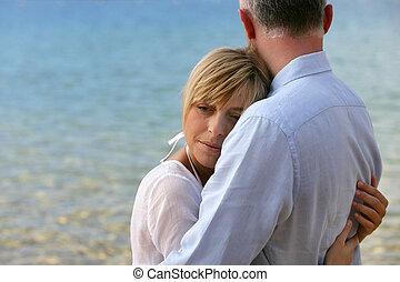 blonde woman hugging her husband