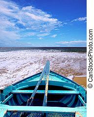 blue canoe in the b