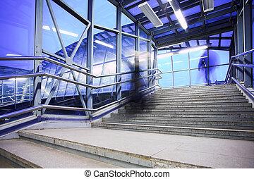 Blue coridor, people mooving near staircase
