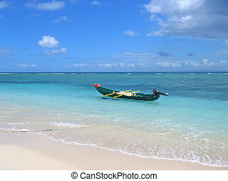 Blue sea with a small motor boat, Nosy Boraha, Sainte, Marie island, Madagascar
