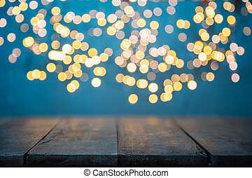 Blurred abstract golden spot lights on blue background. Empty wooden planks on background, ideal for product placement