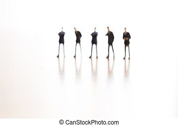 Blurred business people standing on white background
