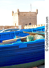 boat in africa morocco old harbor wood and abstract pier