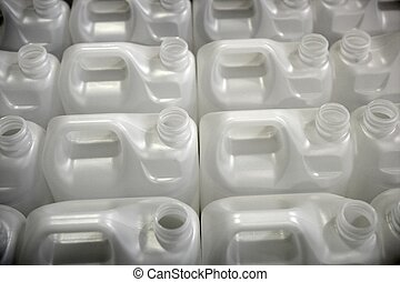 Bottles in factory rows, white plastic environment recycle metaphor
