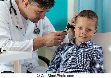 Boy during ear examination