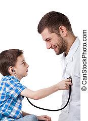 Boy examining a doctor