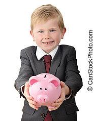 Boy holding piggybank