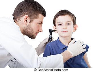 Boy's ear examination