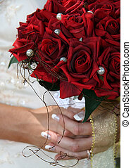 A bride's bouquet of red roses