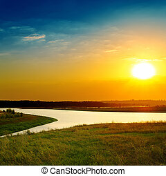 bright sunset over river