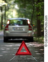 broken down car with warning triangle