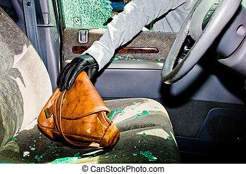 from a broken car, a handbag is stolen