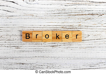 BROKER word made with wooden blocks concept