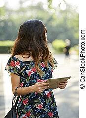 Brunette with Digital Tablet
