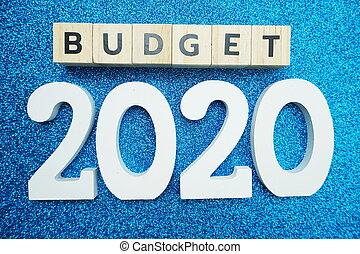 Budget 2020 alphabet letters on blue glitter background
