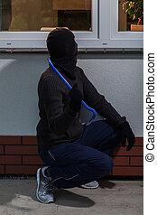 Burglar trying to break