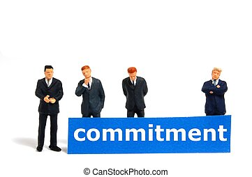 business commitment with small toy man isolated on white background