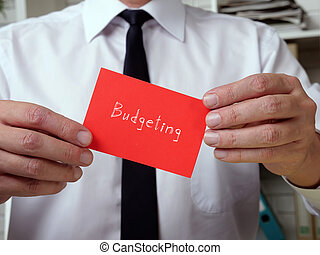 Business concept about Budgeting with inscription on the piece of paper.