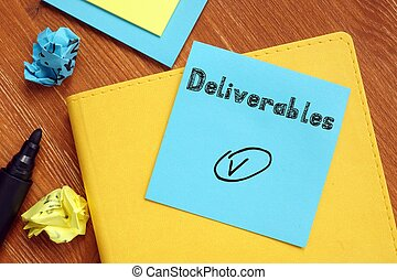 Business concept about Deliverables with inscription on the piece of paper.