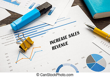 Business concept about Increase Sales Revenue with sign on the sheet.