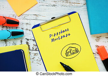 Business concept about Piggyback Mortgage with inscription on the piece of paper.