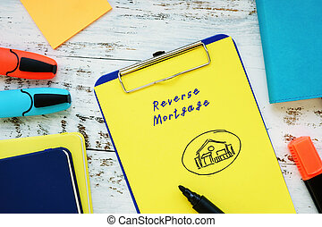 Business concept about Reverse Mortgage with inscription on the piece of paper.