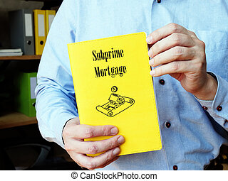 Business concept about Subprime Mortgage with inscription on the piece of paper.