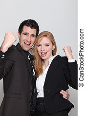 Business couple with their fists in the air