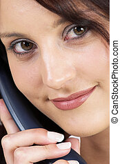 Business woman with blue telephone