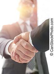 business leader shaking hands with partner.