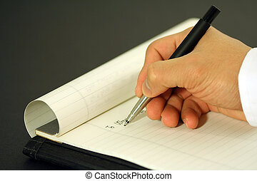 A businessman writing a business letter