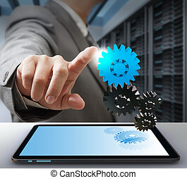 business man touch on gear as computer solution concept