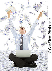 business man winning a lottery with money rain background