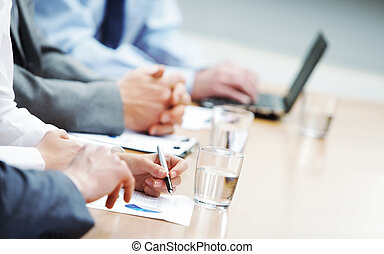Close up of hands of business people during a meeting