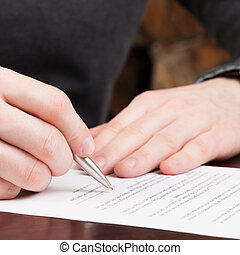 Business men reading contract - 1 to 1 ratio