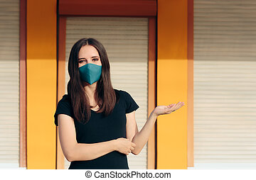 Business Owner Standing in Front of Store ready for Re-Opening