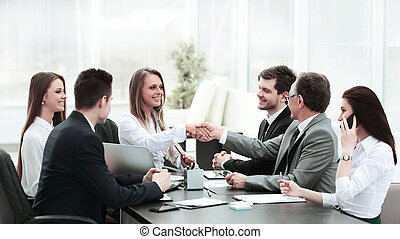 business partners shaking hands after a successful transaction