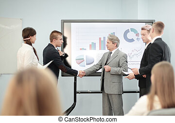 business partners shaking hands after discussing a new commercial project.