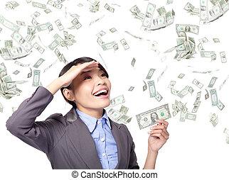 business woman happy with money rain