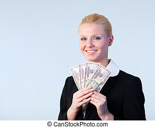 Business woman holding dollars up