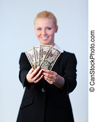 Business woman holding up dollars