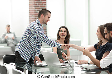 business woman shaking hands with her business partner.