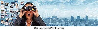 Business woman with binoculars.