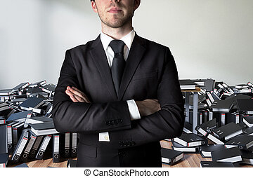 businessman crossed arms in front of a large pile of ring binders paperwork, conceptual burnout 3D Illustration
