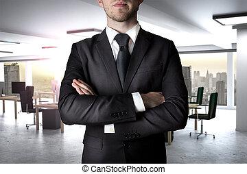 businessman crossed arms in modern office