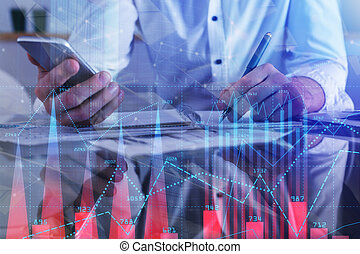 Businessman hands using smartphone and doing paperwork at workplace with abstract forex chart. Financial growth concept. Double exposure