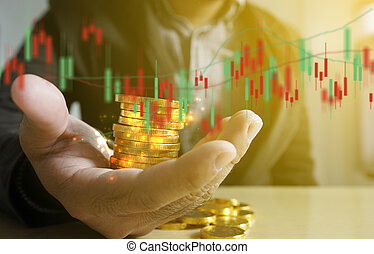 Businessman holding money coins with financial graph. Business Growth concept.
