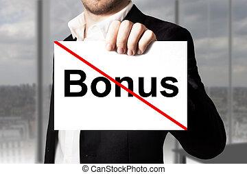 businessman holding sign bonus crossed out